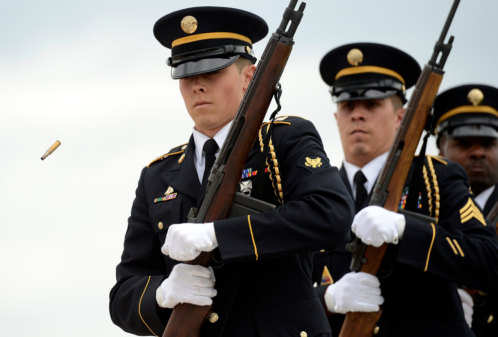 . Firing party - Buckley Air Force Base Honor Guard, fire their weapons during the Colorado Freedom Memorial dedication (Photo By John Leyba/The Denver Post)