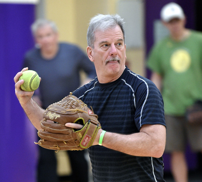 Larry Tironi of Oakland Township winds up to trow a pitch during softball practice at the Rochester Older Persons Commission on March 26, 2018. (Digital First Media Gallery by David Dalton)
