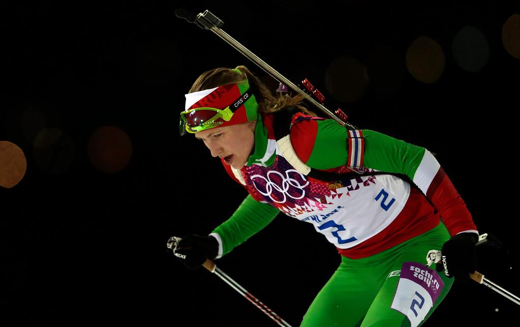 . Belarus\' Darya Domracheva races to win the gold medal in the women\'s biathlon 12.5k mass-start, at the 2014 Winter Olympics, Monday, Feb. 17, 2014, in Krasnaya Polyana, Russia. (AP Photo/Felipe Dana)