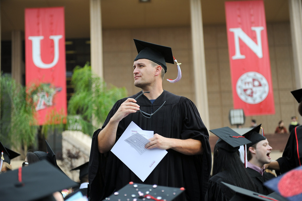 . Communication studies major Joseph Pitillo looks for relatives at the CSUN commencement ceremony, Tuesday, May 21, 2013. (Michael Owen Baker/L.A. Daily News)