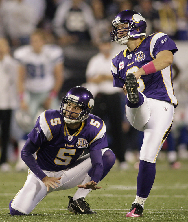 . Minnesota Vikings punter Chris Kluwe (5) watches place kicker Ryan Longwell (8) kick a fourth quarter field goal against the  Dallas Cowboys at Mall of America Field in Minneapolis, Minnesota on Sunday, October 17, 2010. (Paul Moseley/Fort Worth Star-Telegram/MCT)