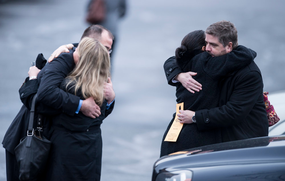Description of . People console each other after the funeral mass for James Mattioli at St. Rose of Lima Roman Catholic Church on December 18, 2012 in Newtown, Connecticut. Mattioli, age 6, is one of the victims from last Friday's shooting at Sandy Hook Elementary School which took the lives of 20 students and 6 adults.    AFP PHOTO/Brendan SMIALOWSKI/AFP/Getty Images