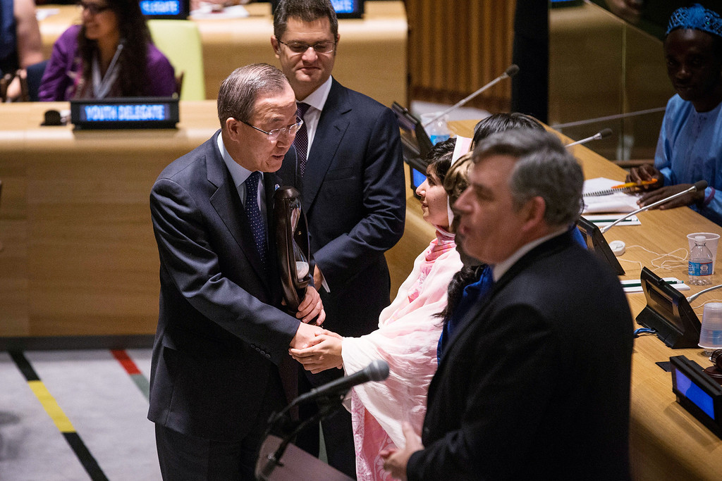 ". NEW YORK, NY - JULY 12:  United Nations Secretary General Ban-ki Moon (L) shakes hands with Malala Yousafzai, the 16-year-old Pakistani advocate for girls education who was shot in the head by the Taliban, at the United Nations (UN) Youth Assembly on July 12, 2013 in New York City. The United Nations declared July 12, ""Malala Day.\"" Yousafzai also celebrates her birthday today.  (Photo by Andrew Burton/Getty Images)"