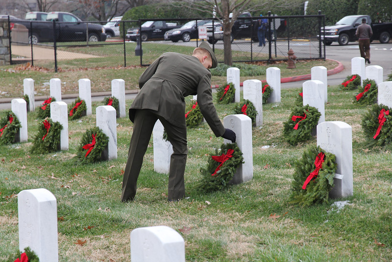 this soldier took such care - he only got one wreath at a time and took a picture of each marker as he laid the wreath