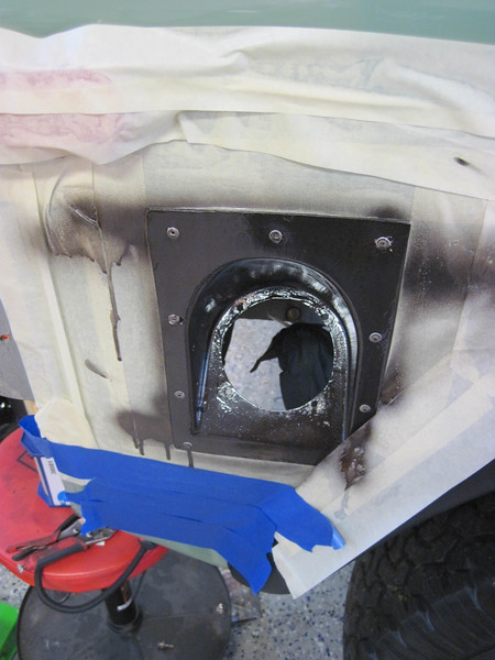 Masking and painting rear gas filler.