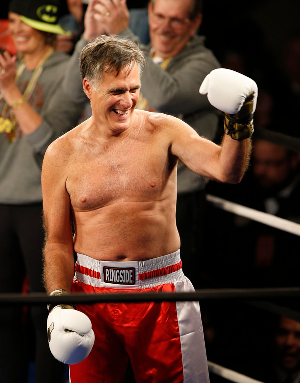 ". Mitt Romney gestures to the crowd during a fight against Evander Holyfield at a charity boxing event on May 15, 2015 in Salt Lake City, Utah. The event was held to raise money for  ""Charity Vision\"" a charity that aims to restore sight to the blind and visually impaired. (Photo by George Frey/Getty Images)"