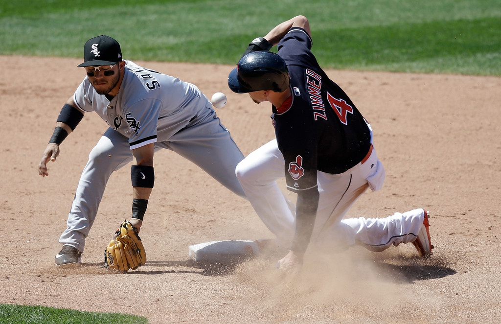 . Cleveland Indians\' Bradley Zimmer is safe on a steal to second base as Chicago White Sox\'s Yolmer Sanchez can\'t handle the ball in the sixth inning of a baseball game, Sunday, June 11, 2017, in Cleveland. Zimmer advanced to third base on a throwing error by catcher Omar Narvaez. The Indians won 4-2. (AP Photo/Tony Dejak)