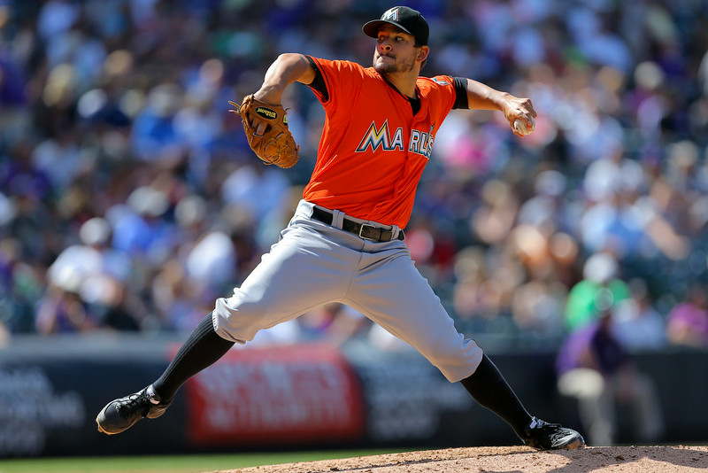 . Starting pitcher Brad Hand #52 of the Miami Marlins delivers to home plate during the third inning against the Colorado Rockies at Coors Field on August 24, 2014 in Denver, Colorado.  (Photo by Justin Edmonds/Getty Images)