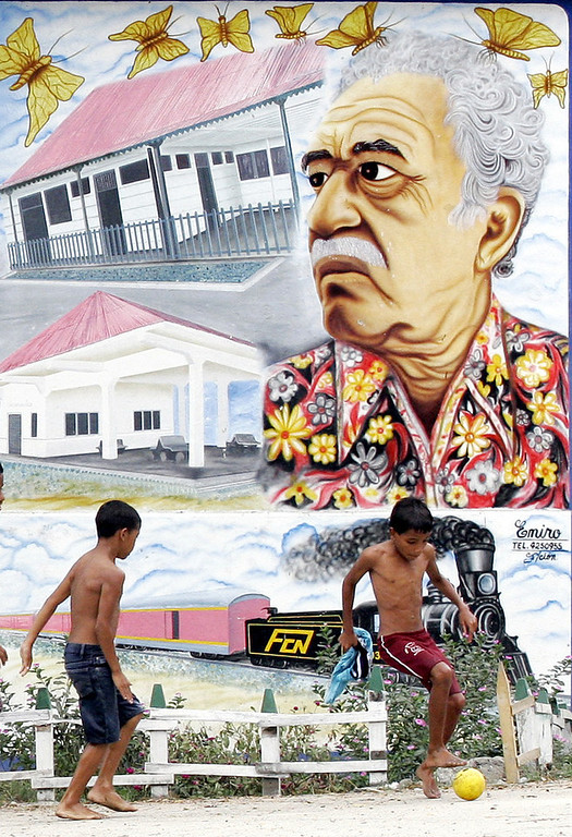 . In this Jan. 4, 2006 file photo, boys play soccer in front a mural of Colombian Nobel laureate Gabriel Garcia Marquez in Aracataca, Colombia, the writer\'s hometown. Marquez died on Thursday, April 17, 2014 at his home in Mexico City. (AP Photo/Fernando Vergara, File)