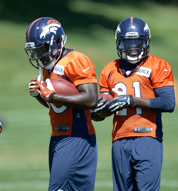. Denver Broncos running back Montee Ball (38) and Denver Broncos running back Ronnie Hillman (21) runs through running drills during practice  August 26, 2013 at Dove Valley. (Photo by John Leyba/The Denver Post)