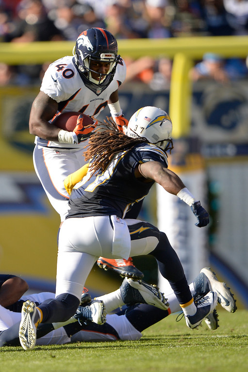 . SAN DIEGO, CA. December 14, - Running back Juwan Thompson #40 of the Denver Broncos picks up yardage in the first half vs the San Diego Chargers at Qualcomm Stadium December 14, 2014 San Diego, CA (Photo By Joe Amon/The Denver Post)