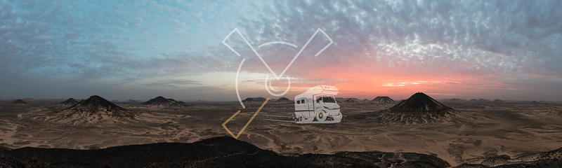 Sunset panorama over the ancient volcanic landscape of the Black desert in Egypt.