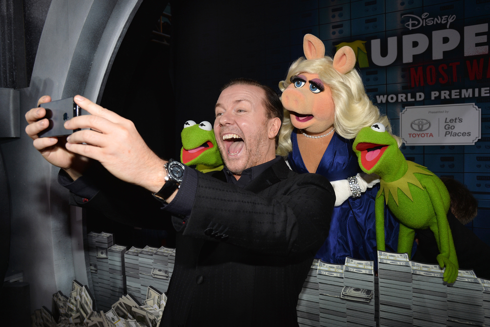 """. (L-R) Constantine, actor/comedian Ricky Gervias, Miss Piggy and Kermit arrive for the premiere of Disney\'s \""""Muppets Most Wanted\"""" at the El Capitan Theatre on March 11, 2014 in Hollywood, California.  (Photo by Kevin Winter/Getty Images)"""