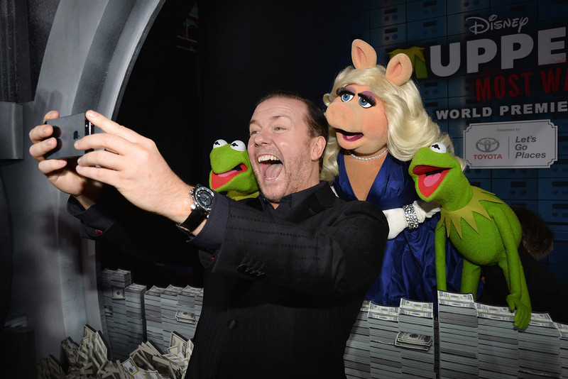 ". (L-R) Constantine, actor/comedian Ricky Gervias, Miss Piggy and Kermit arrive for the premiere of Disney\'s ""Muppets Most Wanted\"" at the El Capitan Theatre on March 11, 2014 in Hollywood, California.  (Photo by Kevin Winter/Getty Images)"