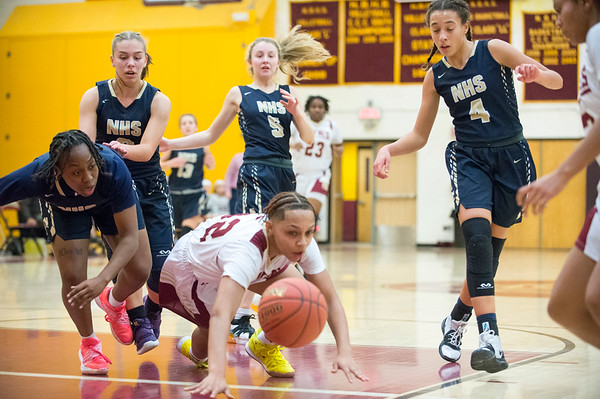 01/0719 Wesley Bunnell | StaffrrNew Britain girls basketball vs Newington at NBHS on Tuesday evening. Ashanti Frazier (10) and lRaven Symone Jarrett (32) fight for a loose ball.