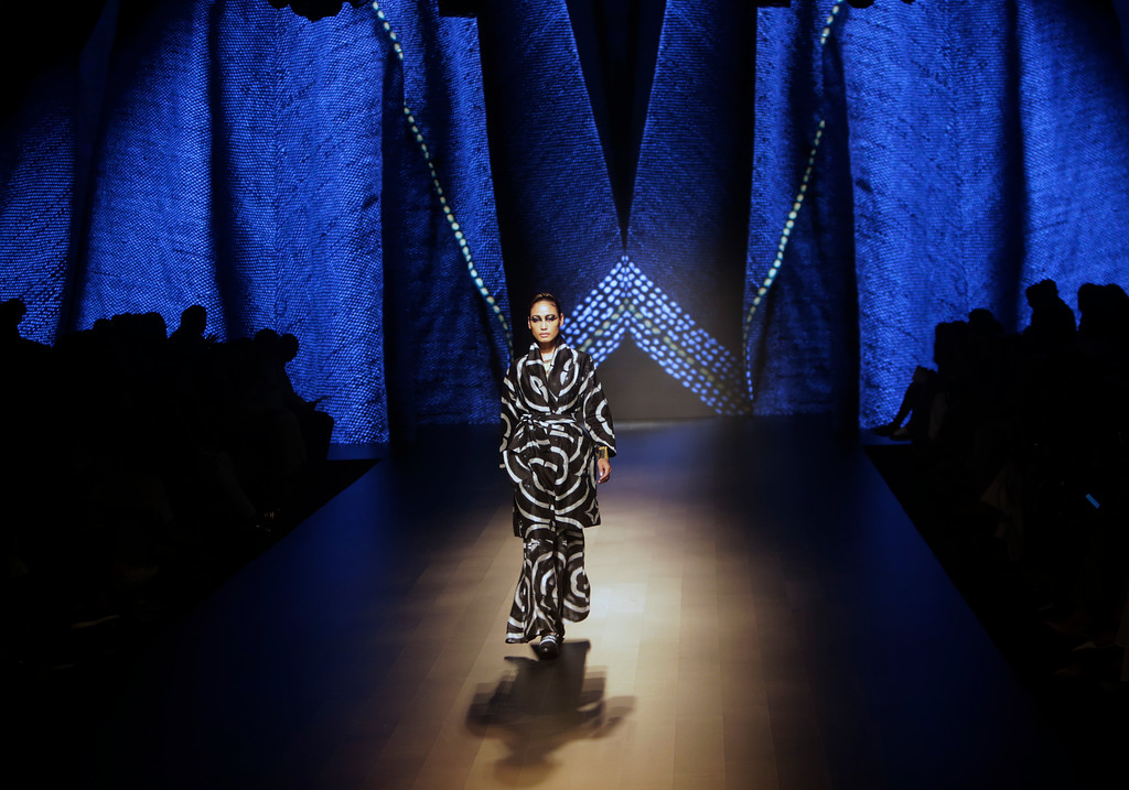 . A model walks the ramp to showcase the creation of designer fashion label Amrich  during the Lakme fashion week winter in Mumbai, India, Wednesday, Aug. 22, 2018. (AP Photo/Rajanish Kakade)