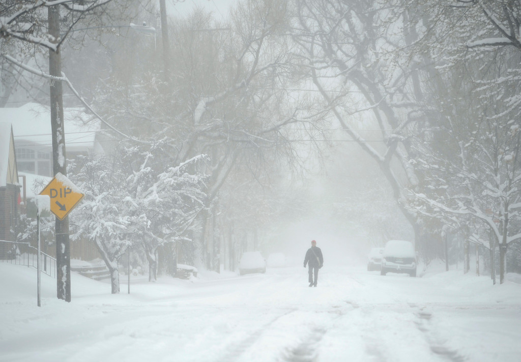 . DENVER, CO.- MARCH 23: A pedestrian prefers the street to the sidewalk as they make their way through the Park Hill neighborhood. Snow arrived overnight in Denver and for much of Colorado with a foot or more expected in some areas of the foothills and eastern planes. (Photo By Kathryn Scott Osler/The Denver Post)
