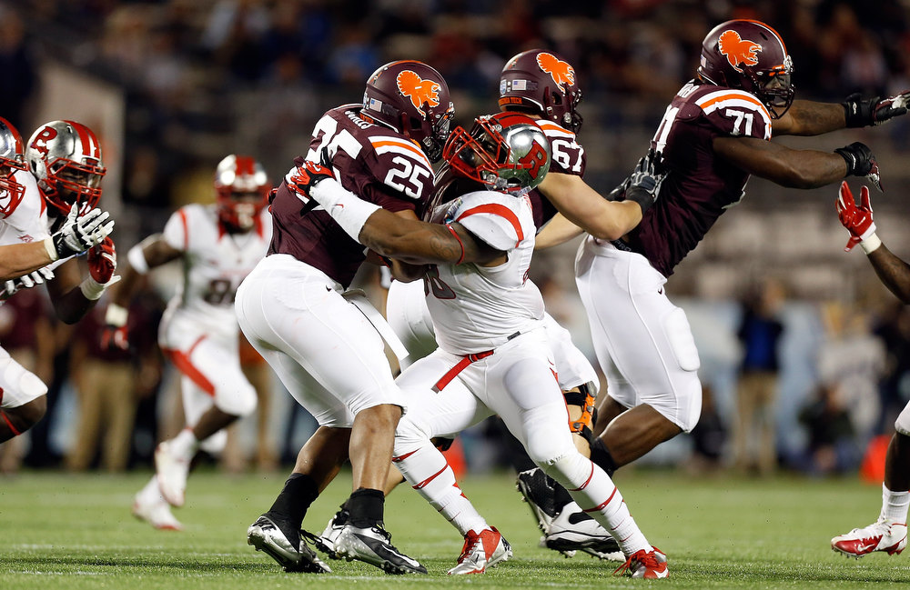 . Linebacker Dallas Whitaker #48 of the Rutgers Scarlet Knights tackes running back Martin Scales #25 of the Virginia Tech Hokies during the Russell Athletic Bowl Game at the Florida Citrus Bowl on December 28, 2012 in Orlando, Florida.  (Photo by J. Meric/Getty Images)