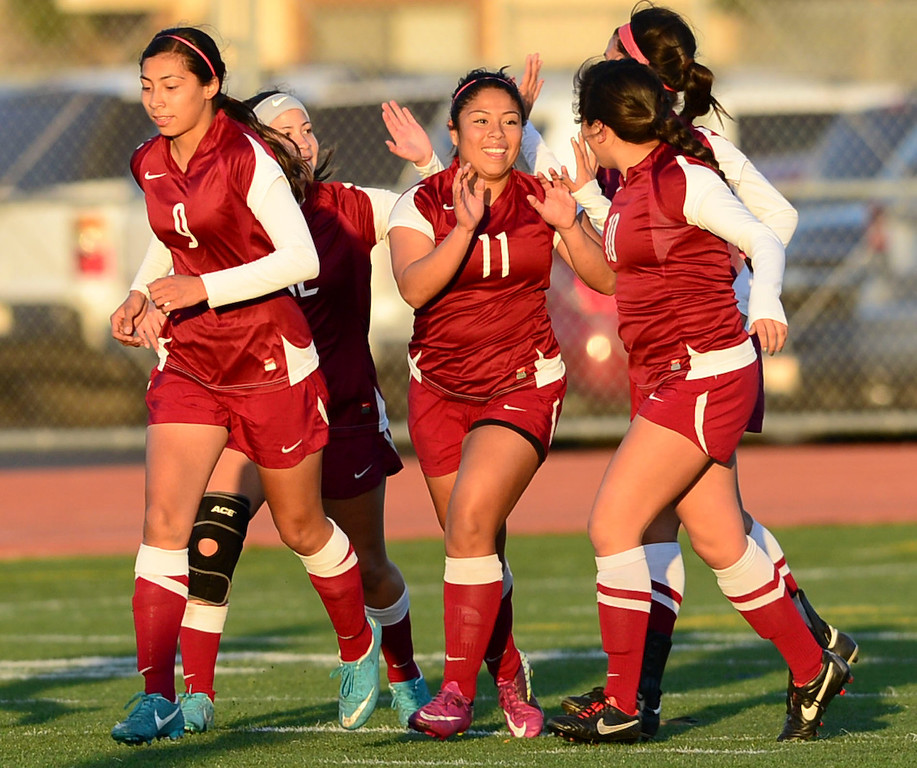 . Downey\'s Cindy Rodriguez (11) celebrates her goal against Torrance in a CIF SS Division IV quarterfinal game Thursday at Zamperini Field. Downey won the game 3-1. 20130221 Photo by Steve McCrank / Staff Photographer
