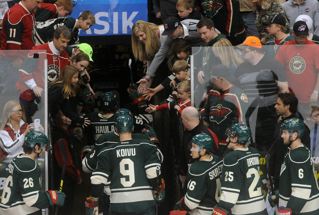 . The Minnesota Wild leave the ice after losing 7-3 in their last game of the season against the Nashville Predators,   at the Xcel Energy Center in St. Paul on April 13, 2014.  (Pioneer Press: Scott Takushi)