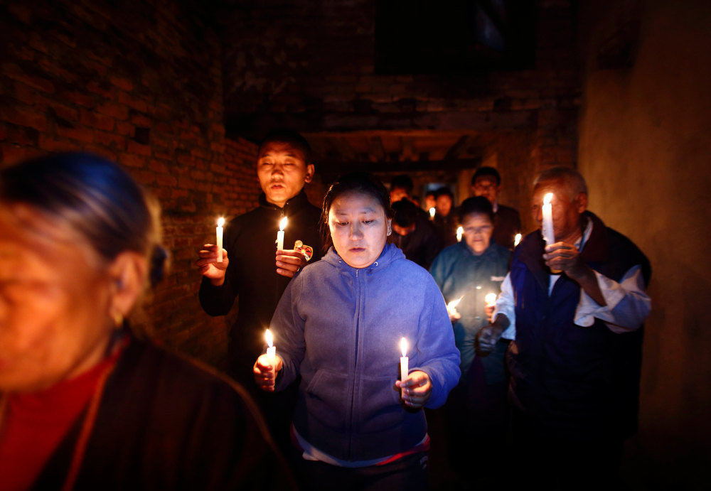 Description of . Tibetans holding lit candles walk around the Tibetan Refugee Camp during a candlelight vigil to show solidarity to Tibetans who have self-immolated, and to mark the 100th anniversary of the 1913 Tibetan Proclamation of Independence, in Lalitpur February 13, 2013. A Tibetan monk self-immolated on Wednesday at the premises of the Boudhanath Stupa in Kathmandu. REUTERS/Navesh Chitrakar