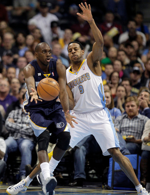 . Denver Nuggets Andre Iguodala (9) guards Memphis Grizzlies Quincy Pondexter in the second quarter of a NBA game in Denver on Friday, Dec. 14, 2012.(AP Photo/Joe Mahoney)