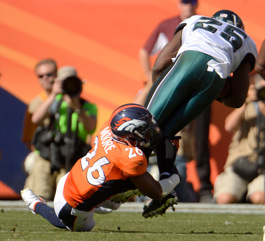 . Denver Broncos free safety Rahim Moore (26) wraps up Philadelphia Eagles running back LeSean McCoy (25) during the second quarter. (Photo by Joe Amon/The Denver Post)