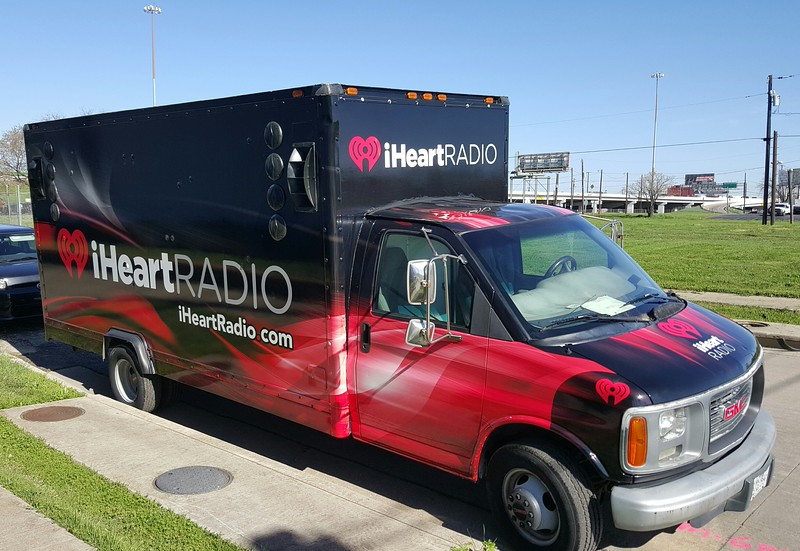 Speaker-equipped box truck with custom-designed SkinzWrap for iHeartRADIO and Dallas' Annual St. Paddy's Day Parade