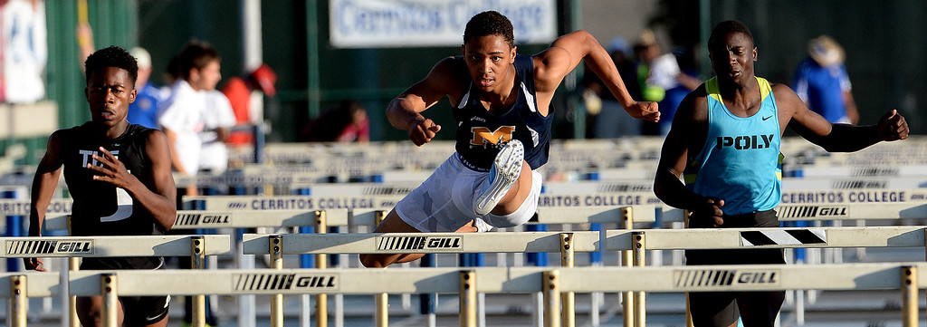 . Millikan\'s Misana Viltz, center, along with Upland\'s Joseph Anderson, left, and Long Beach Poly\'s Juan Ward competes in the 110 meter hurdles during the CIF-SS Masters Track and Field meet at Falcon Field on the campus of Cerritos College in Norwalk, Calif., on Friday, May 30, 2014.   (Keith Birmingham/Pasadena Star-News)
