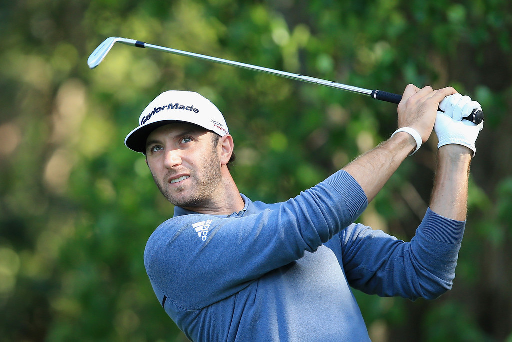 . Dustin Johnson hits a shot during the 2014 Par 3 Contest prior to the start of the 2014 Masters Tournament at Augusta National Golf Club on April 9, 2014 in Augusta, Georgia.  (Photo by David Cannon/Getty Images)
