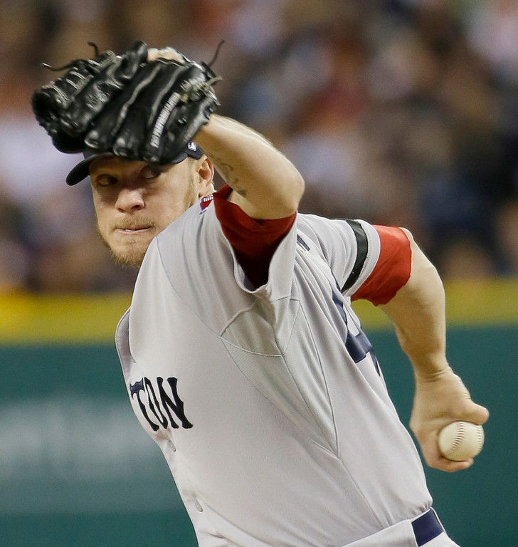 . Boston Red Sox starting pitcher Jake Peavy throws in the first inning during Game 4 of the American League baseball championship series against the Detroit Tigers, Wednesday, Oct. 16, 2013, in Detroit. (AP Photo/Matt Slocum)