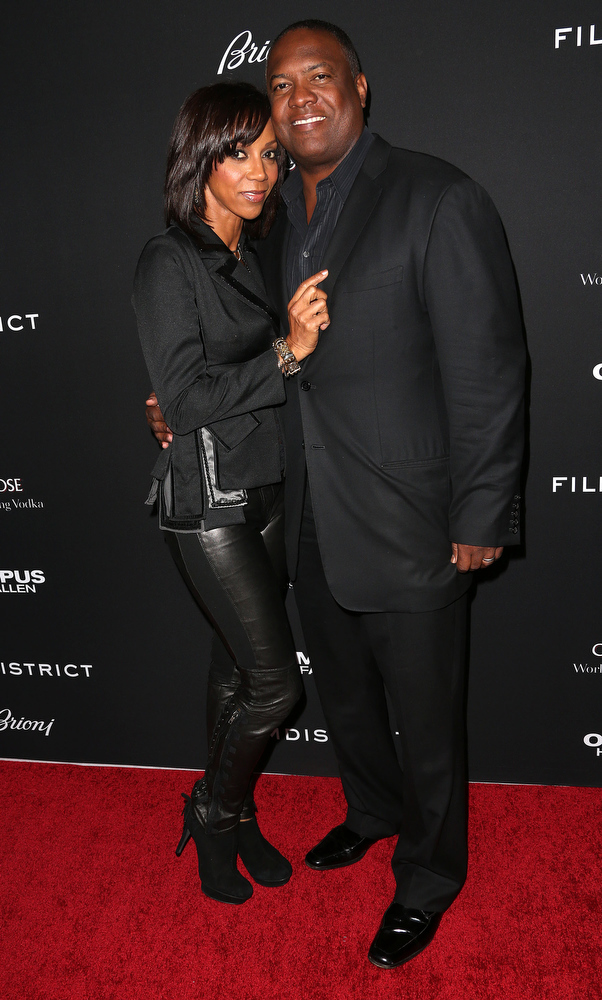 """. Actress Holly Robinson Peete (L) and Rodney Peete attend the Premiere of FilmDistrict\'s \""""Olympus Has Fallen\"""" at the ArcLight Cinemas Cinerama Dome on March 18, 2013 in Hollywood, California.  (Photo by Frederick M. Brown/Getty Images)"""