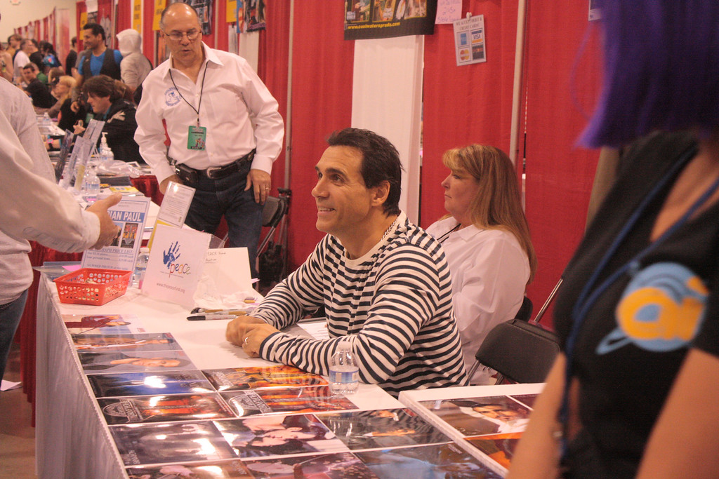 """. Actor Adrian Paul, known for his role Duncan McLeod in \""""The Highlander,\"""" greets a fan at the Motor City Comic Con on Saturday. (Photo by Erica McClain)"""