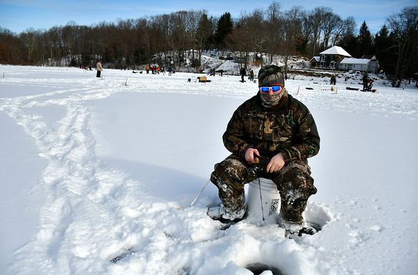 2/2/2019 Mike Orazzi | Staff Brody Serafin while fishing on Middle Pond for the Terryville Fish & Game Clubs annual Ice Fishing Derby Saturday in Plymouth.