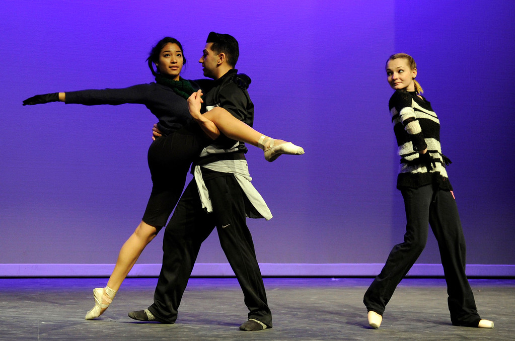""". Andrea Herrera of Antioch, left, Ricky Navarro of Pittsburg, and Alexandra Lengyel of Brentwood, members of the Black Diamond Ballet Theatre, rehearse to \""""Let\'s Do It, Let\'s Fall In Love\"""" during a dress rehearsal in preparation for the Jan. 19 opening gala at the restored California Theatre in Pittsburg, Calif. on Tuesday, Jan. 15, 2013.  (Susan Tripp Pollard/Staff)"""