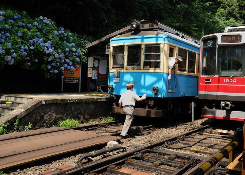 The mountain climbing trains run on a single track, but pass each other at Miyanoshita.