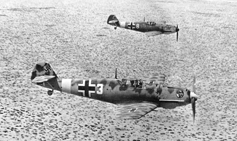 Messerschmitt-Bf-109E7Trop-1.JG27-White-3-and-8-on-low-level-patrol-over-Libya-Feb-1942-06.jpg