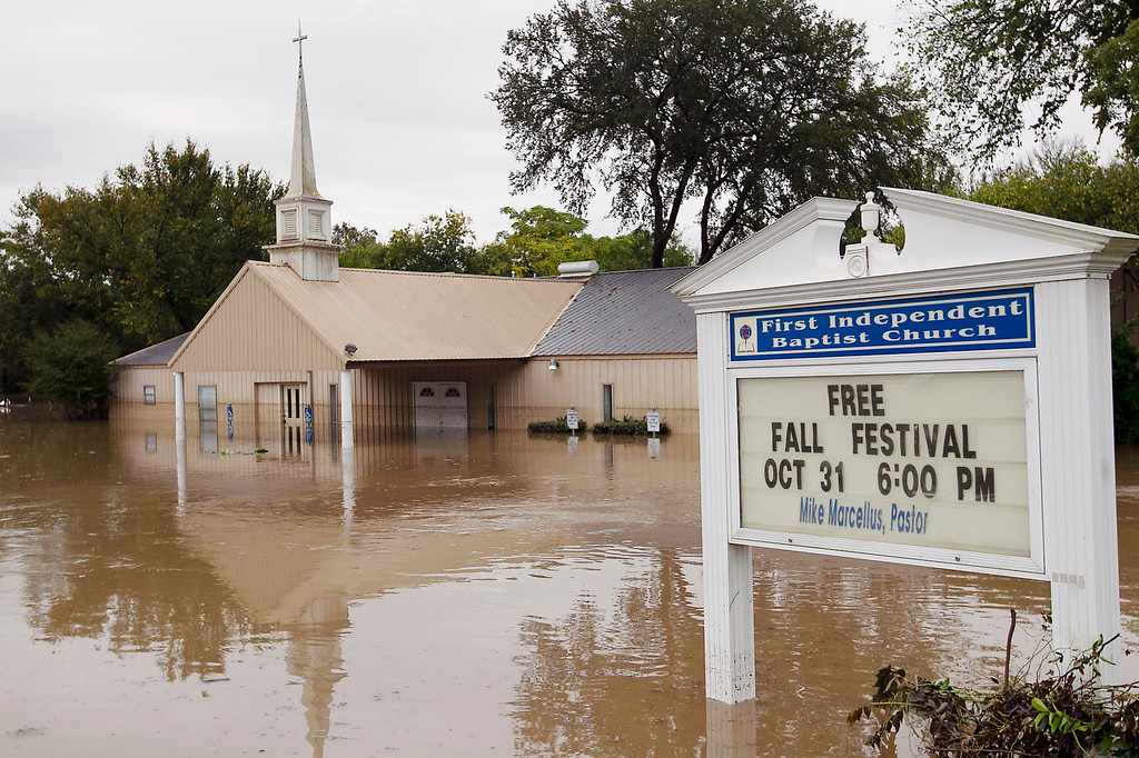 . This photo shows the First Independent Baptist Church on Bluff Springs Road underwater in Austin, Texas, on Thursday, Oct. 31, 2013. Heavy overnight rains brought flooding to the area. (AP Photo/Austin American-Statesman, Ralph Barrera)