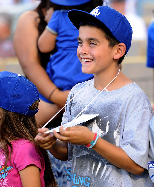 . William smiles as the families are announced on the field as members of the San Fernando Valley Rescue Mission are treated to a Major league baseball game between the Miami Marlins and the Los Angeles Dodgers on Wednesday, May 14, 2014 in Los Angeles. The Mission experienced a devastating fire earlier this month. Damage sustained included the destruction of the San Fernando Valley Rescue Mission�s emergency shelter, vehicle fleet, clothing warehouse and food pantry which were vital in aiding those of need in the San Fernando Valley.  (Keith Birmingham/Pasadena Star-News)