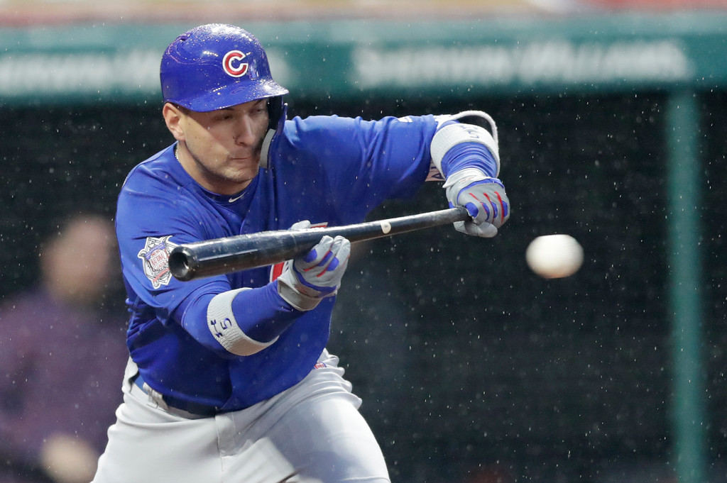 . Chicago Cubs\' Albert Almora Jr. bunts against Cleveland Indians relief pitcher Zach McAllister in the seventh inning of a baseball game, Tuesday, April 24, 2018, in Cleveland. Jason Heyward scored on the play. (AP Photo/Tony Dejak)