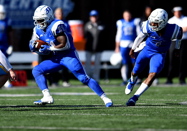 10/26/2019 Mike Orazzi | Staff CCSU's Enyce Walker (31) and Aaron Winchester (1) during Saturday's football game with Long Island University in New Britain.