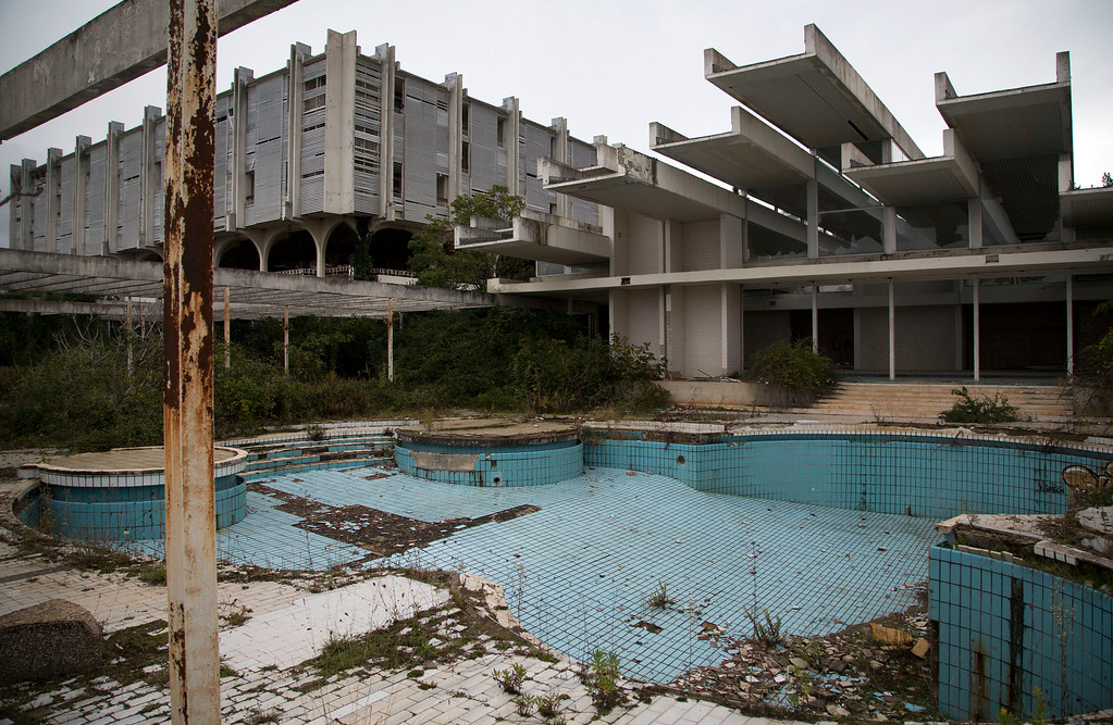 . This Oct. 23, 2014, photo shows a swimming pool at the abandoned Palace hotel at deserted tourist resort of Haludovo, near Malinska on the northern Adriatic island of Krk, Croatia. The resort was built as a joint venture of Yugoslav communist government and Bob Guccione, the founder of the Penthouse magazine. The resort was intended as a haven of extreme decadence for upscale vacationers on the Adriatic Sea. Today, it sits abandoned due to ownership issues and mismanagement. (AP Photo/Darko Bandic)