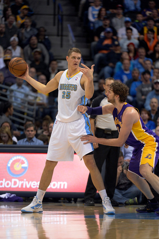 . DENVER, CO - NOVEMBER 13: Denver Nuggets center Timofey Mozgov (25) looks to pass the ball as Los Angeles Lakers center Pau Gasol (16) defends on the play during the third quarter November 13, 2013 at Pepsi Center. Timofey Mozgov had a team high 23 points.  (Photo by John Leyba/The Denver Post)