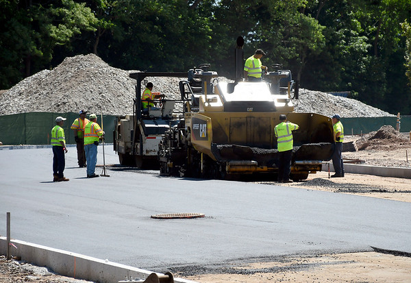 6/29/2018 Mike Orazzi | Staff Crews paving the new road being put in downtown Bristol Frirday through Centre Square,