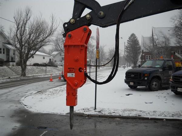 NPK GH4 hydraulic hammer on Deere backhoe (7).JPG