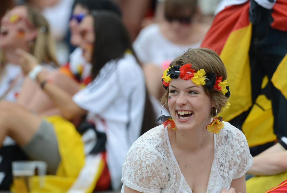 . A German fan cheers during a public viewing of the FIFA World Cup 2014 quarter final football match between Germany and France in Munich, southern Germany on July 4, 2014. (CHRISTOF STACHE/AFP/Getty Images)