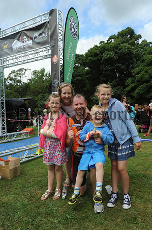 RS1433131 Dad David O'Prey gets a celebratory welcome from his family at the finish