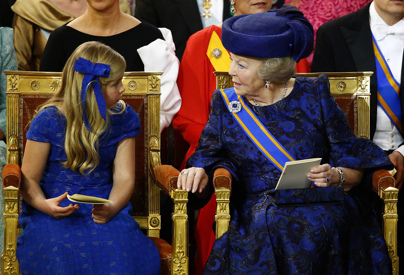 . Dutch Princess Beatrix, right, speaks with Princess Catharina-Amalia at the Nieuwe Kerk or New Church in Amsterdam, The Netherlands, prior to the inauguration of King Willem-Alexander, Tuesday April 30, 2013. (AP Photo/Michael Kooren, Pool)