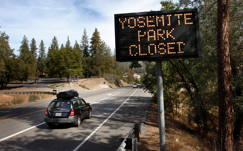 """. A sign on Route 41 in Oakhurst, Calif., notifies travelers that Yosemite National Park is closed Tuesday, Oct. 1, 2013. The shutdown of the federal government overnight meant that some federal employees, such as rangers who staff national parks, were furloughed as their positions are considered \""""non-essential.\"""" The shutdown means anyone who is in Yosemite National Park has 48 hours to leave if the House and Senate can\'t come to an agreement on a funding bill that puts the federal government back in business. (Patrick Tehan/Bay Area News Group)"""