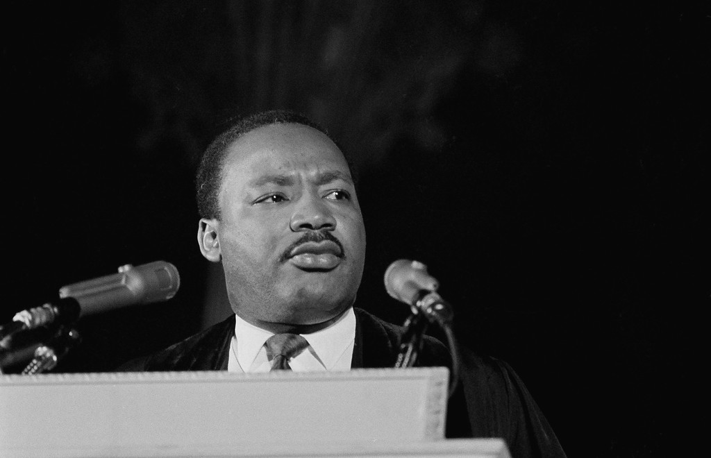 ". Dr. Martin Luther King, Jr., left, who heads the Southern Christian Leadership Conference, addresses a capacity crowd from the pulpit at the National Cathedral in Washington, D.C., March 31, 1968. Discussing his proposed demonstrations at the capital, tentatively set for June 15, Dr. King said ""We\'re not coming to tear Washington apart. We\'re coming to demand to know if the government will address itself to the problems of poverty.\"" (AP Photo/John Rous)"